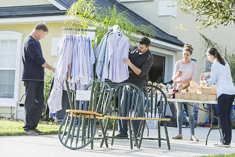 Men and women searching through items at a garage sale